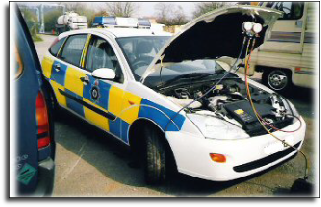 A police Ford Focus undergoing service to its air conditioning system